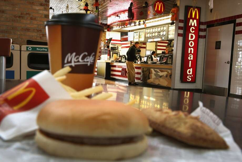 DES PLAINES, IL - OCTOBER 24:  In this photo illustration, Customers order food from a McDonald's restaurant on October 24, 2013 in Des Plaines, Illinois. McDonald's has announced it will make changes to its low-priced Dollar Menu, which includes items like coffee, small fries, hamburgers and apple pies. The new menu, dubbed the Dollar Menu and More, will offer some higher priced options such as the grilled Onion Cheddar Burger and a McChicken sandwich.  (Photo by Scott Olson/Getty Images) Photo: Getty Images