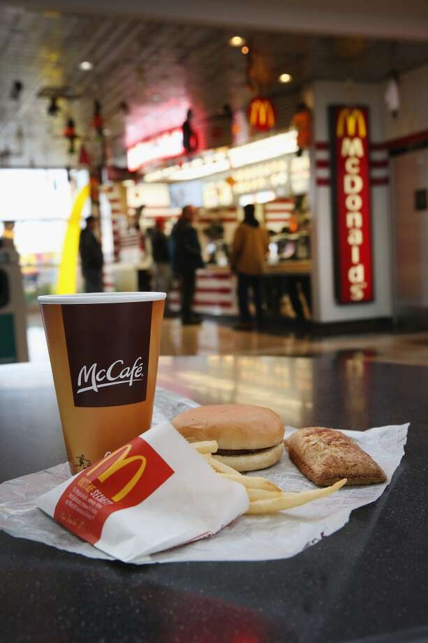 DES PLAINES, IL - OCTOBER 24:  In this photo illustration, items are shown from a McDonald's restaurant on October 24, 2013 in Des Plaines, Illinois. McDonald's has announced it will make changes to its low-priced Dollar Menu, which includes items like coffee, small fries, hamburgers and apple pies. The new menu, dubbed the Dollar Menu and More, will offer some higher priced options such as the grilled Onion Cheddar Burger and a McChicken sandwich.  (Photo Illustration by Scott Olson/Getty Images) Photo: Getty Images