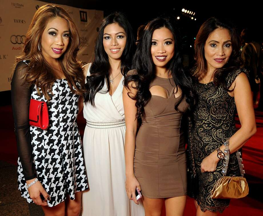 From left: Lem Quilet, Jennie Gonzales, China Quilet and Rhodora Gerona on the red carpet at Fashion Houston at the Wortham Theater Wednesday Nov.13. Photo: Dave Rossman, For The Houston Chronicle