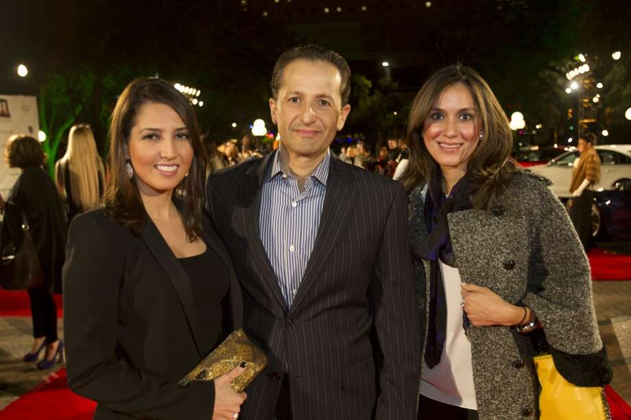 Neda Etminan, left, Ali Etminan and Heidi Kashani pose for a photo during Fashion Houston at Wortham Center Tuesday, Nov. 12. Photo: Brett Coomer, Houston Chronicle