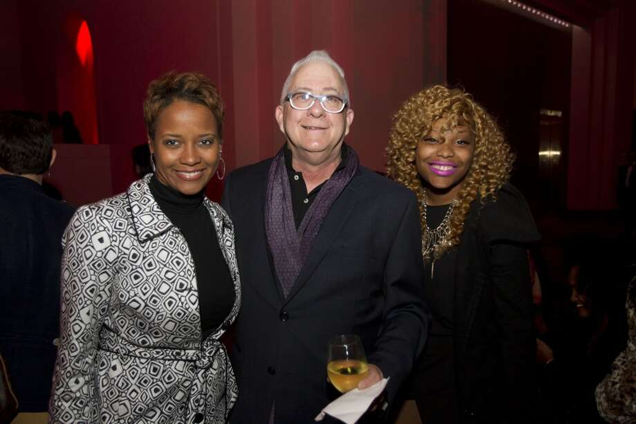 Deanna Laster, left, Ken Simmons and Shantae Smith  pose for a photo before Fashion Houston at Wortham Center Tuesday, Nov. 12. Photo: Brett Coomer, Houston Chronicle