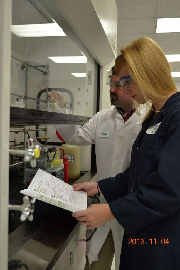 Research and development staff work on product development at the new Shrieve Technology Center in The Woodlands.
