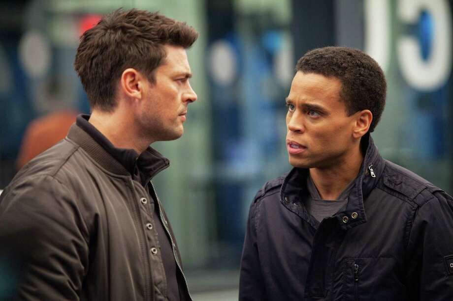 A warm and workable partnership is formed when a part-human robot (Michael Ealy, right) pairs up with a part-machine cop (Karl Urban) to fight crime in a futuristic world. Photo: Fox