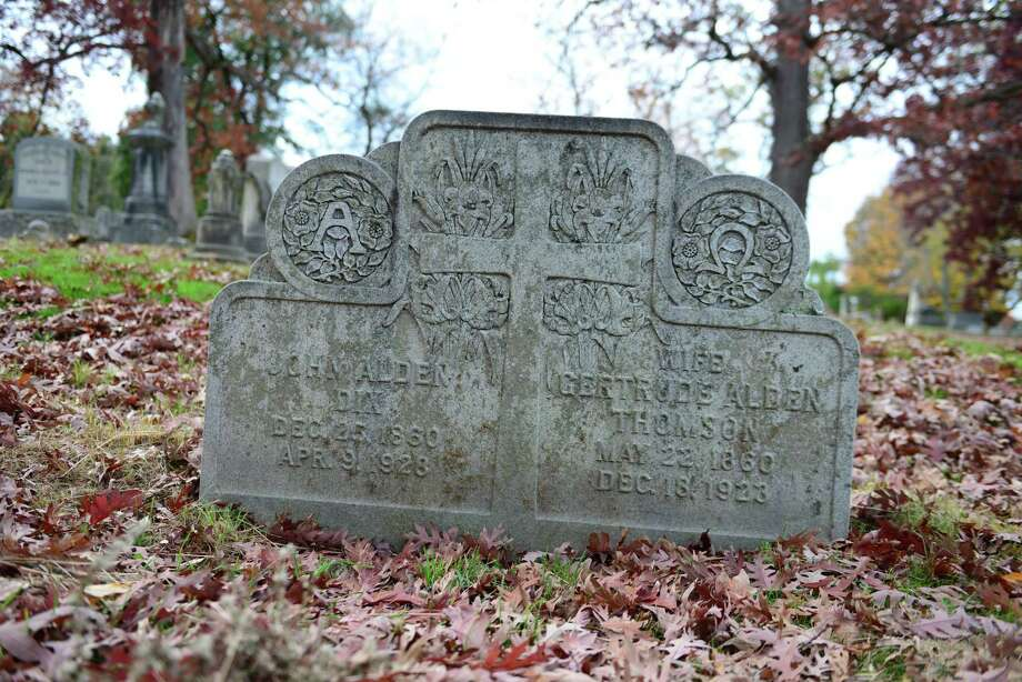 Grave marker of John Alden Dix and his wife, Gertude Thomson. (Will Waldron/Times Photo: Will Waldron, Times Union / 00023993A