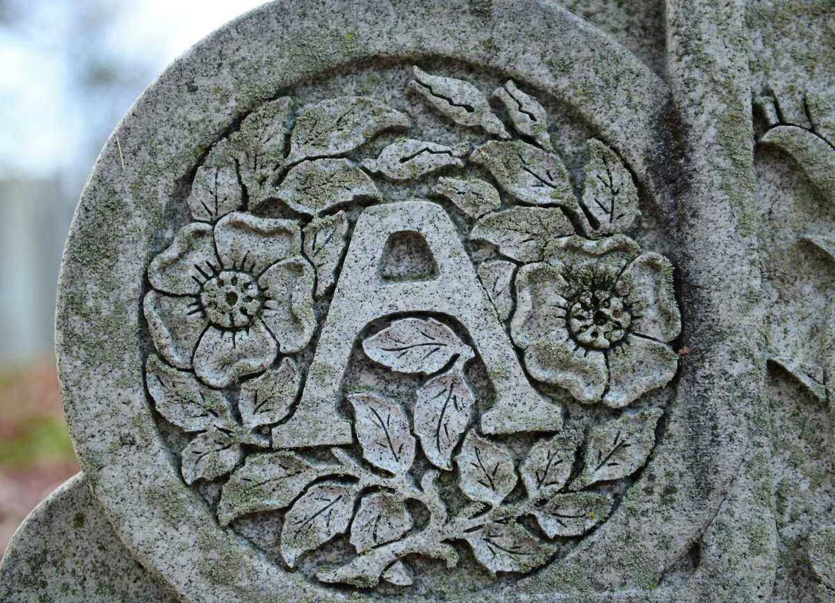 A detail of the grave marker of John Alden Dix and his wife, Gertude Thomson.