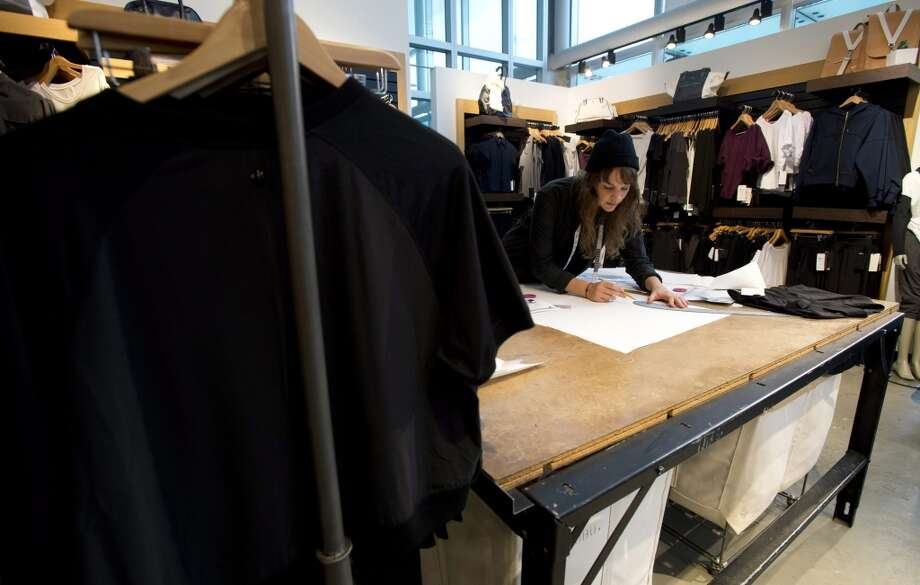 This Nov. 5, 2013, photo shows designer Emily Spence at work inside the Lululemon Lab in Vancouver, British Columbia. (AP Photo/The Canadian Press, Jonathan Hayward) Photo: Associated Press