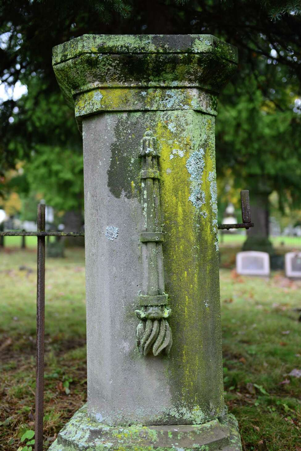 An upside down torch marks the entrance into the James family plot at Albany Rural Cemetery. The orientation of the torch is said to symbolize the end of life. (Will Waldron/Times Union)