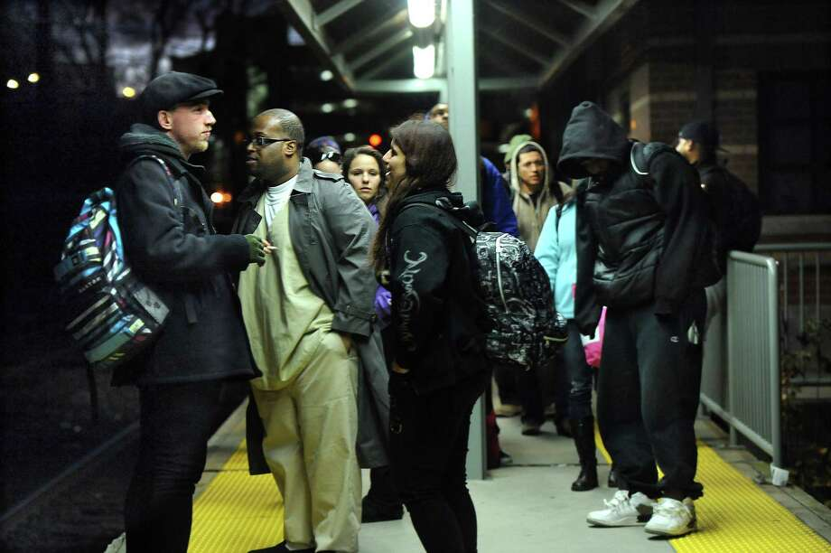 Commuters wait for the 5:15 p.m. train to arrive at the Danbury Train Station Thursday, Nov. 14, 2013. Photo: Carol Kaliff / The News-Times