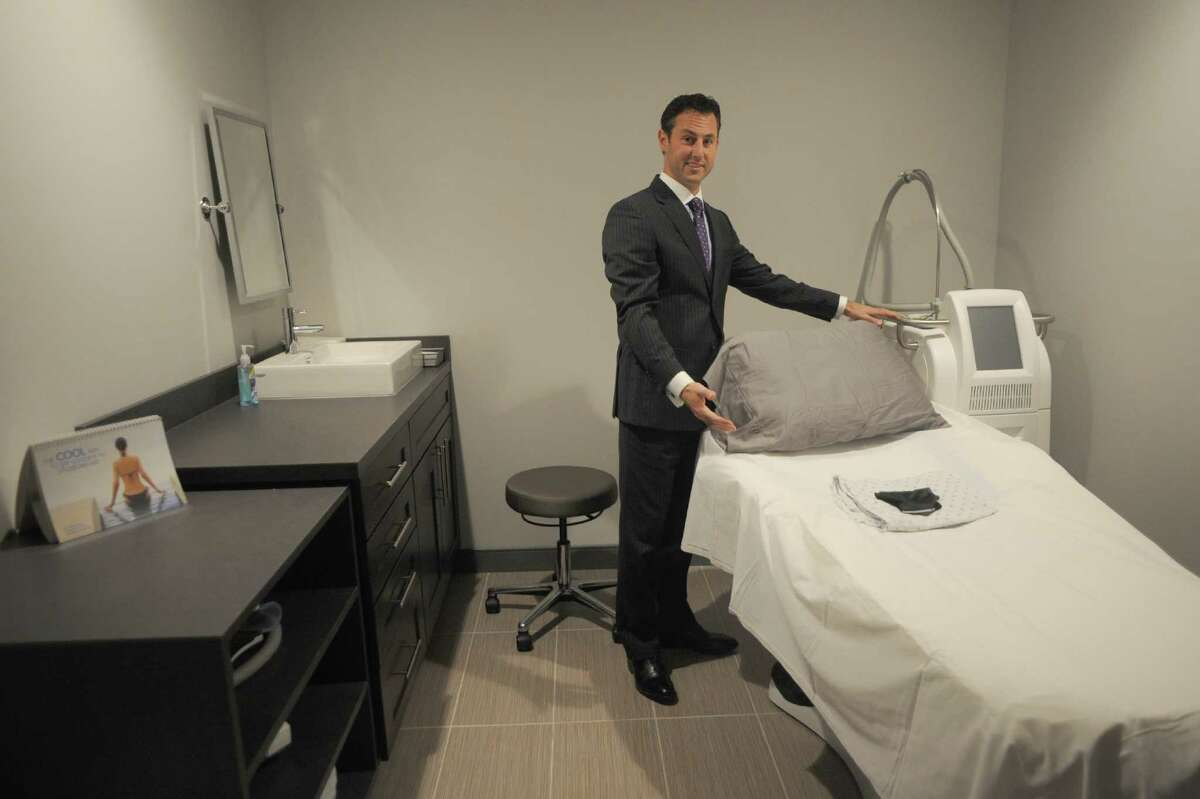 Dr. Jeffrey Rockmore shows a new surgical suite at the Plastic Surgery Group's new offices and spa on Thursday Nov. 14, 2013 in Albany, N.Y. (Michael P. Farrell/Times Union)