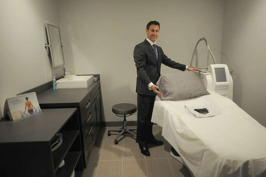 Dr. Jeffrey Rockmore shows a new surgical suite at the Plastic Surgery Group's new offices and spa on Thursday Nov. 14, 2013 in Albany, N.Y.  (Michael P. Farrell/Times Union) Photo: Michael P. Farrell / 00024639A