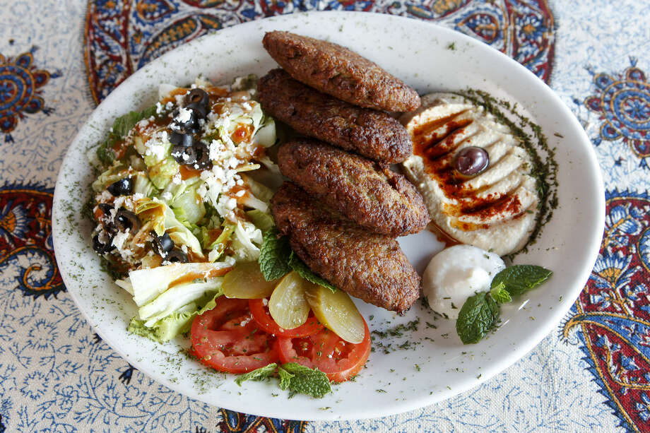 Persian cutlets are a mixture of mashed potatoes and ground beef. All the meat served at Naara Café is halal. Photo: Photos By Marvin Pfeiffer / San Antonio Express-News