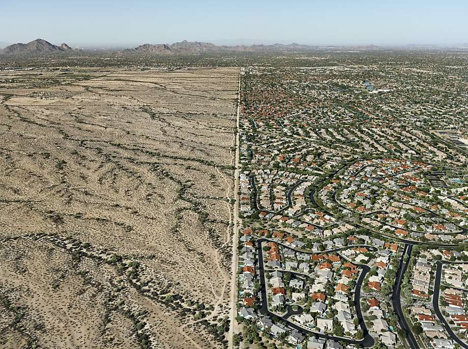 """Reservation/Suburb, Scottsdale Arizona, USA"" (2011) by Edward Burtynsky shows the boundary between the Navajo Reservation and the Phoenix suburb. Photo: Edward Burtynsky"