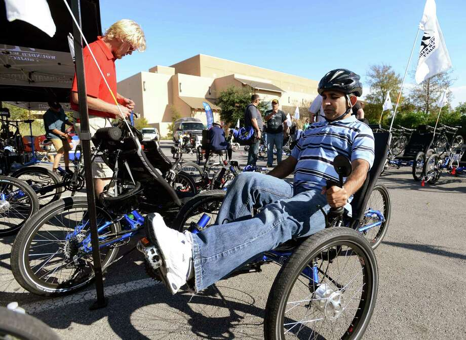 Former Army Sgt. Sheikh Qaisar tries out the cycle that he will use in the upcoming Soldier Ride, a Wounded Warrior Project cycling event from Nov. 14-17. Photo: Billy Calzada, San Antonio Express-News / San Antonio Express-News