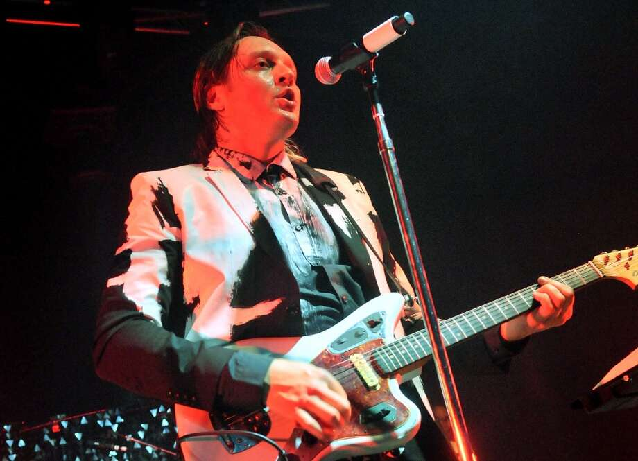 LONDON, ENGLAND - NOVEMBER 11:  Win Butler of Arcade Fire performs live on stage, during a tour billed under the name 'The Reflektors', at The Roundhouse on November 11, 2013 in London, England.  (Photo by Jim Dyson/Getty Images) Photo: Jim Dyson, Getty Images