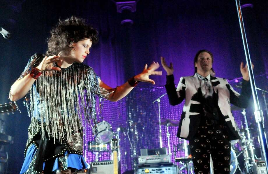 LONDON, ENGLAND - NOVEMBER 11:  Win Butler and  Regine Chassagne of Arcade Fire perform live on stage, during a tour billed under the name 'The Reflektors', at The Roundhouse on November 11, 2013 in London, England.  (Photo by Jim Dyson/Getty Images) Photo: Jim Dyson, Getty Images