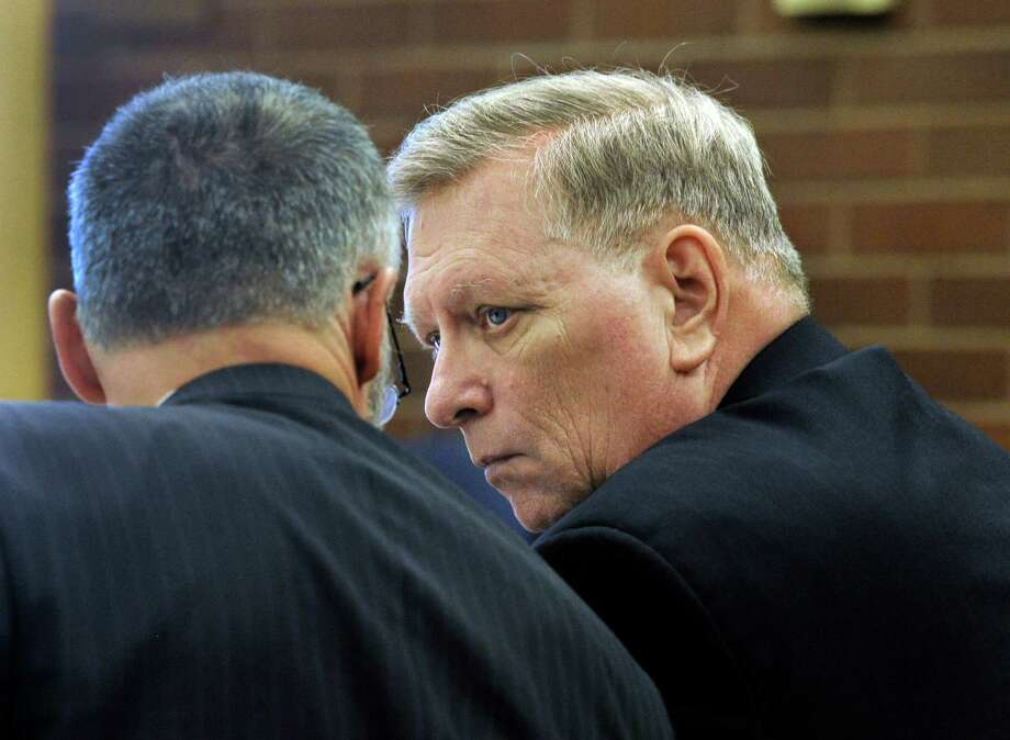 In this file photo, Robert Bell, right, confers with his attorney, John Gulash, on the first day of his manslaughter trial at the Danbury Superior Court, in Danbury, Conn. Wednesday, Nov. 6, 2013. Bell is accused of fatally shooting his wife. Photo: Carol Kaliff / The News-Times