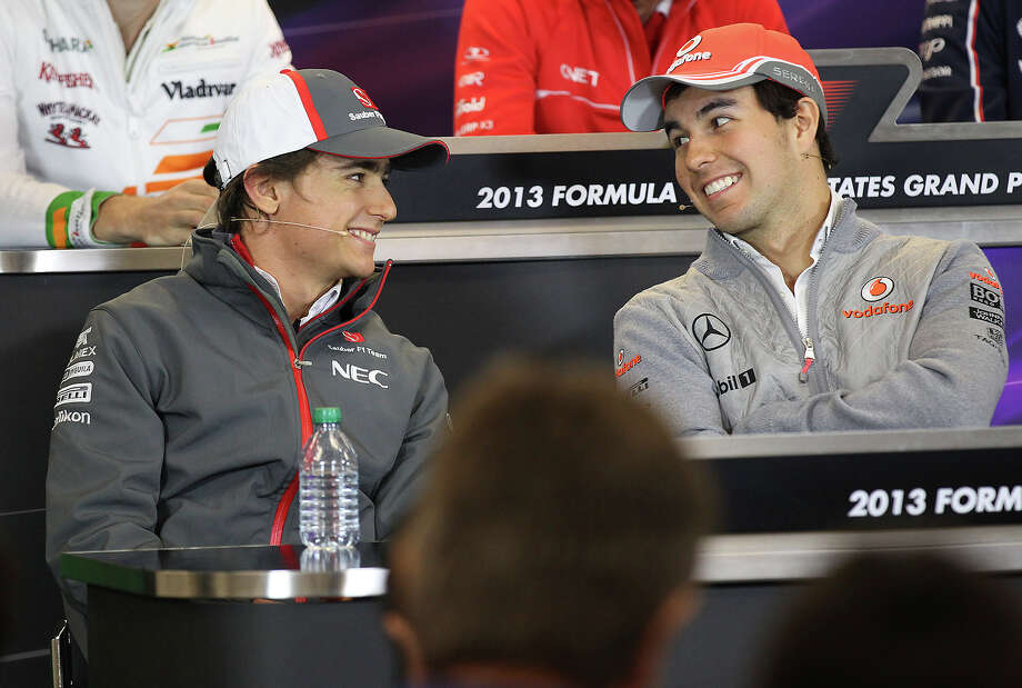 Sauber driver Esteban Gutierrez (left) and McLaren driver Sergio Perez (right) share a laugh during a press conference at the Circuit of the Americas near Austin, Texas on Thursday, Nov. 14, 2013. Photo: Kin Man Hui, San Antonio Express-News / ©2013 San Antonio Express-News