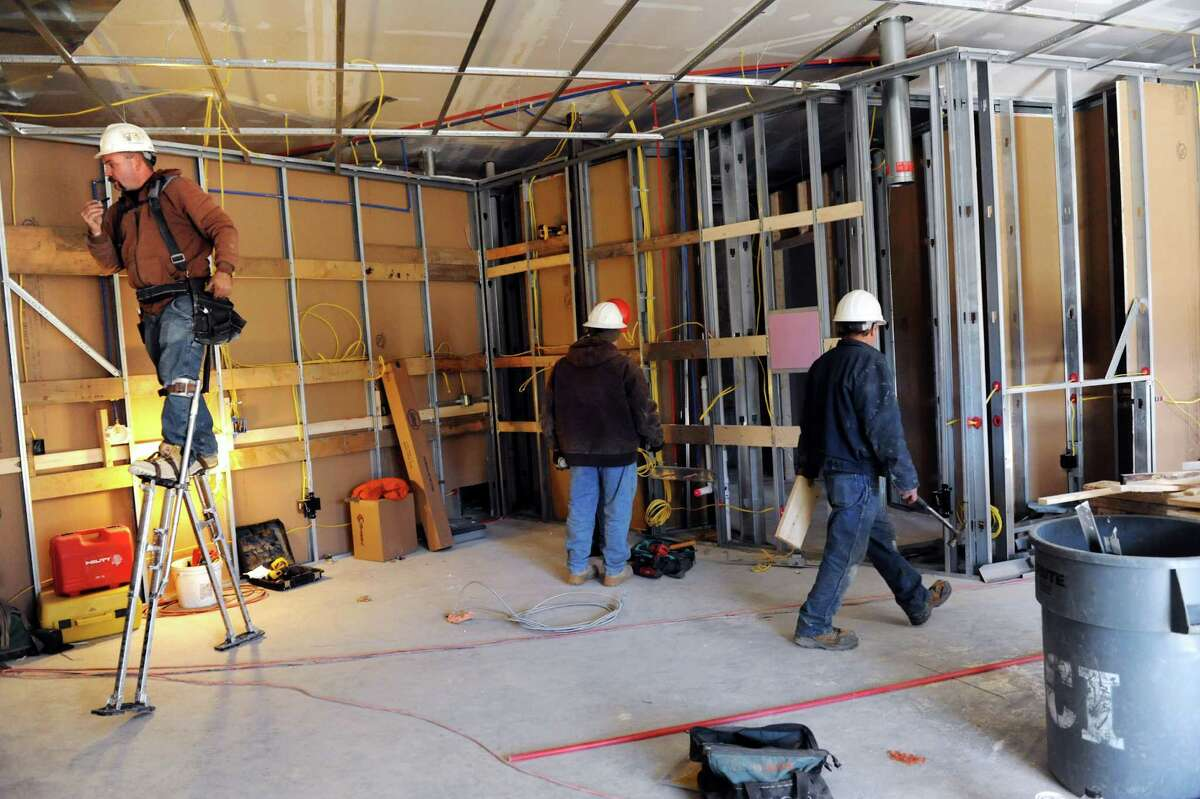 Construction workers labor on the interior of The Loudon House Condominiums Wednesday, Nov. 13, 2013, in Loudonville, N.Y. (Cindy Schultz / Times Union)
