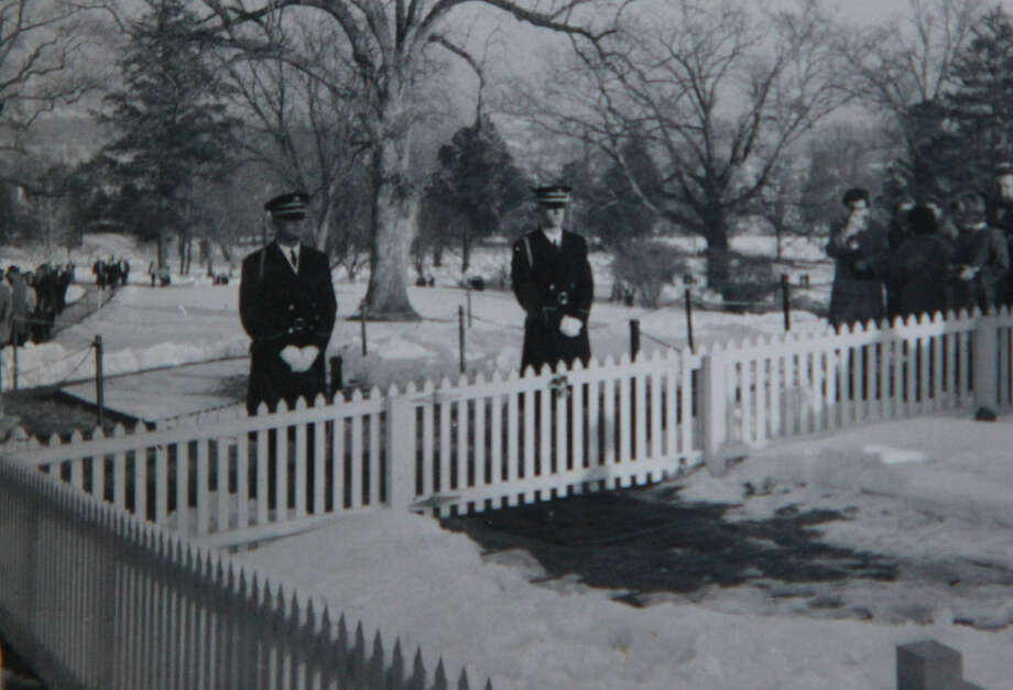 "The soldier standing on the right above is Schertz resident Fred Reimers, who at the time of John F. Kennedy's death was a member of the  ""Old Guard"" Honor Guard. Reimers served in Kennedy's funeral procession. The picture was made at Kennedy's burial site. Photo: Courtesy Photo"