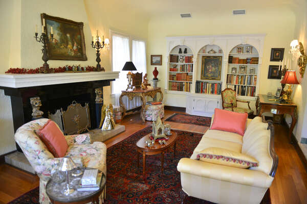 The main living room features restored 19th century European and American furniture along with marble busts, Chinese cinnabar vases and Persian rugs.