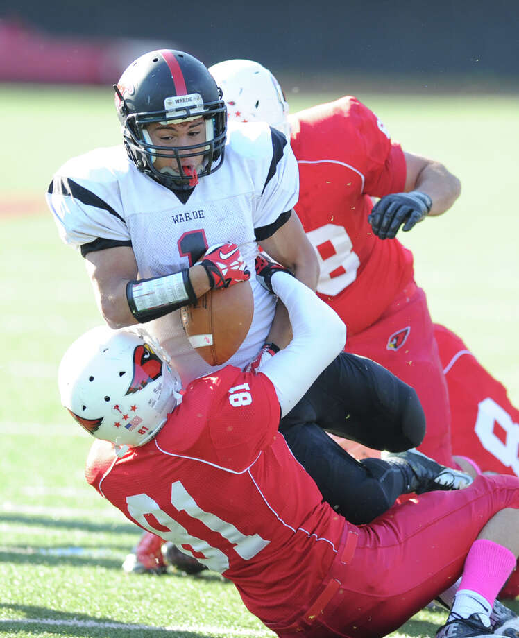 Fairfield Warde running back  Colin Ventura (# 1) is stopped near the goal line by Stephen Lewis (# 81) during first quarter action in the high school football game between Greenwich High School and Fairfield Warde High School at Greenwich, Saturday, Oct. 26, 2013. Greenwich defeated Warde, 42-7. Photo: Bob Luckey / Greenwich Time