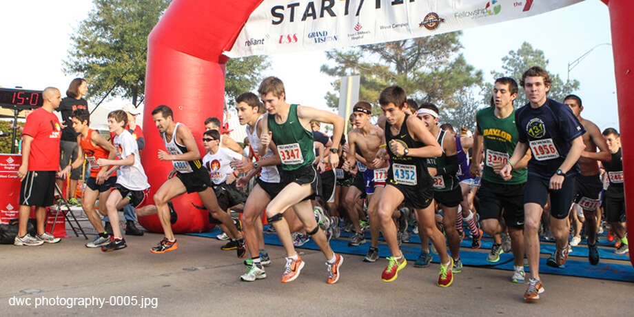 Runners begin one of the Turkey Dash races. Photo: Photo Courtesy Of DWC Photography