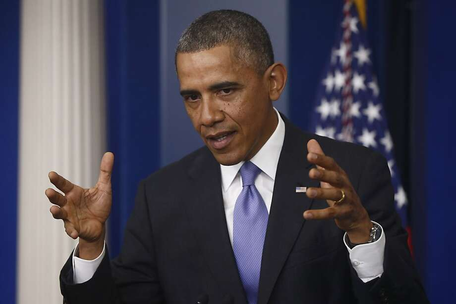 President Obama explains how proposed changes to the health care law would work at a White House news conference. Photo: Charles Dharapak, Associated Press