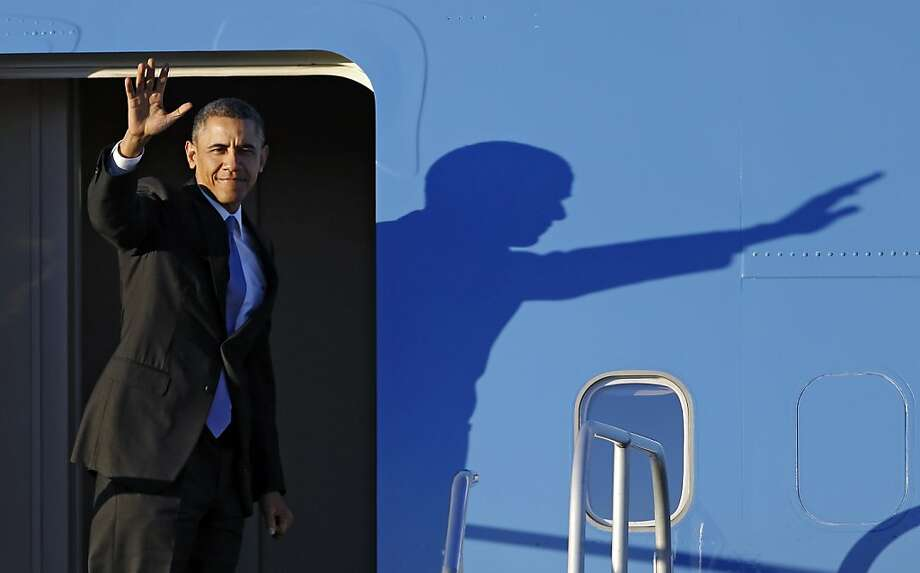 President Barack Obama wavers before boarding Air Force One at Cleveland Hopkins International Airport Thursday, Nov. 14, 2013. Obama spoke on the economy at the ArcelorMittal steel mill in the city.(AP Photo/Mark Duncan) Photo: Mark Duncan, Associated Press