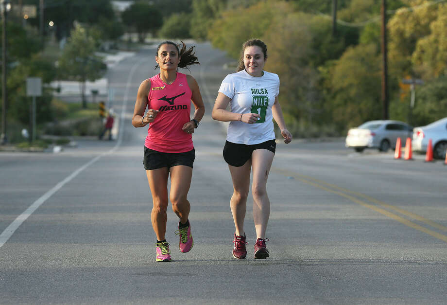 Amber Galvan runs with  her mom Liza Hunter-Galvan on November 14, 2013. Photo: TOM REEL