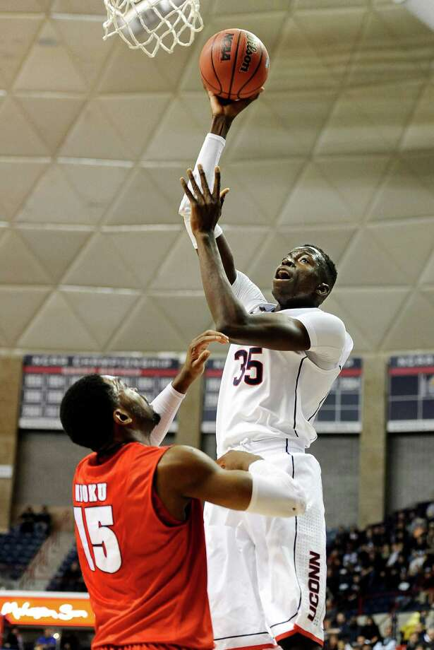 Connecticut's Amida Brimah, right, shoots over Detroit's Ugochukwu Njoku during the first half of an NCAA college basketball game Thursday, Nov. 14, 2013, in Storrs, Conn. Photo: Jessica Hill, AP / Associated Press