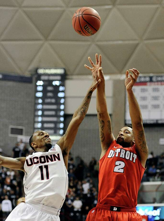 Detroit's Juwan Howard, Jr. shoots over Connecticut's Ryan Boatright during the first half of an NCAA college basketball game Thursday, Nov. 14, 2013, in Storrs, Conn. Photo: Jessica Hill, AP / Associated Press
