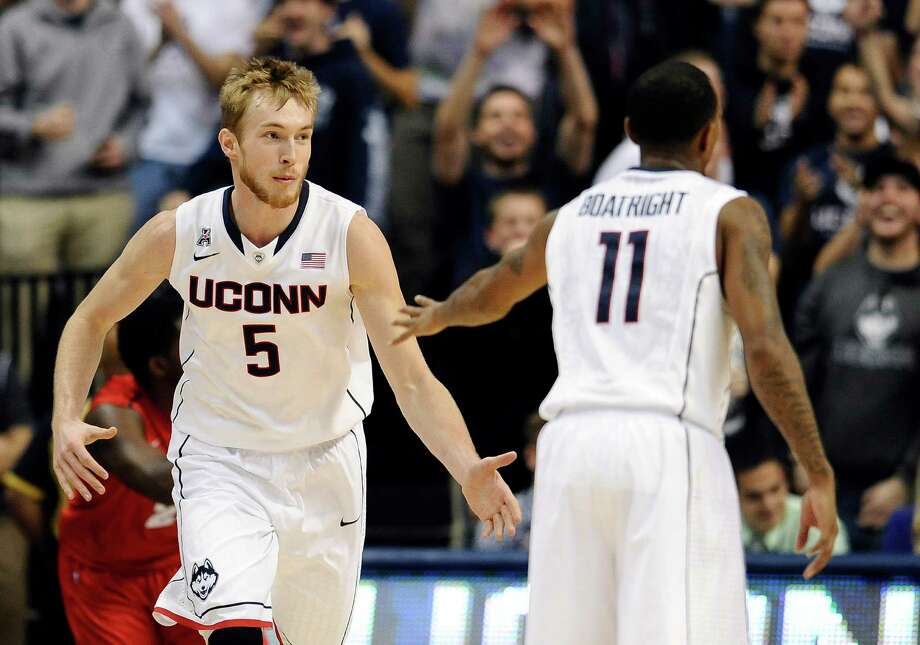 Connecticut's Niels Giffey, left, and Ryan Boatright celebrate a basket by Giffey during the first half of an NCAA college basketball game Thursday, Nov. 14, 2013, in Storrs, Conn. Photo: Jessica Hill, AP / Associated Press