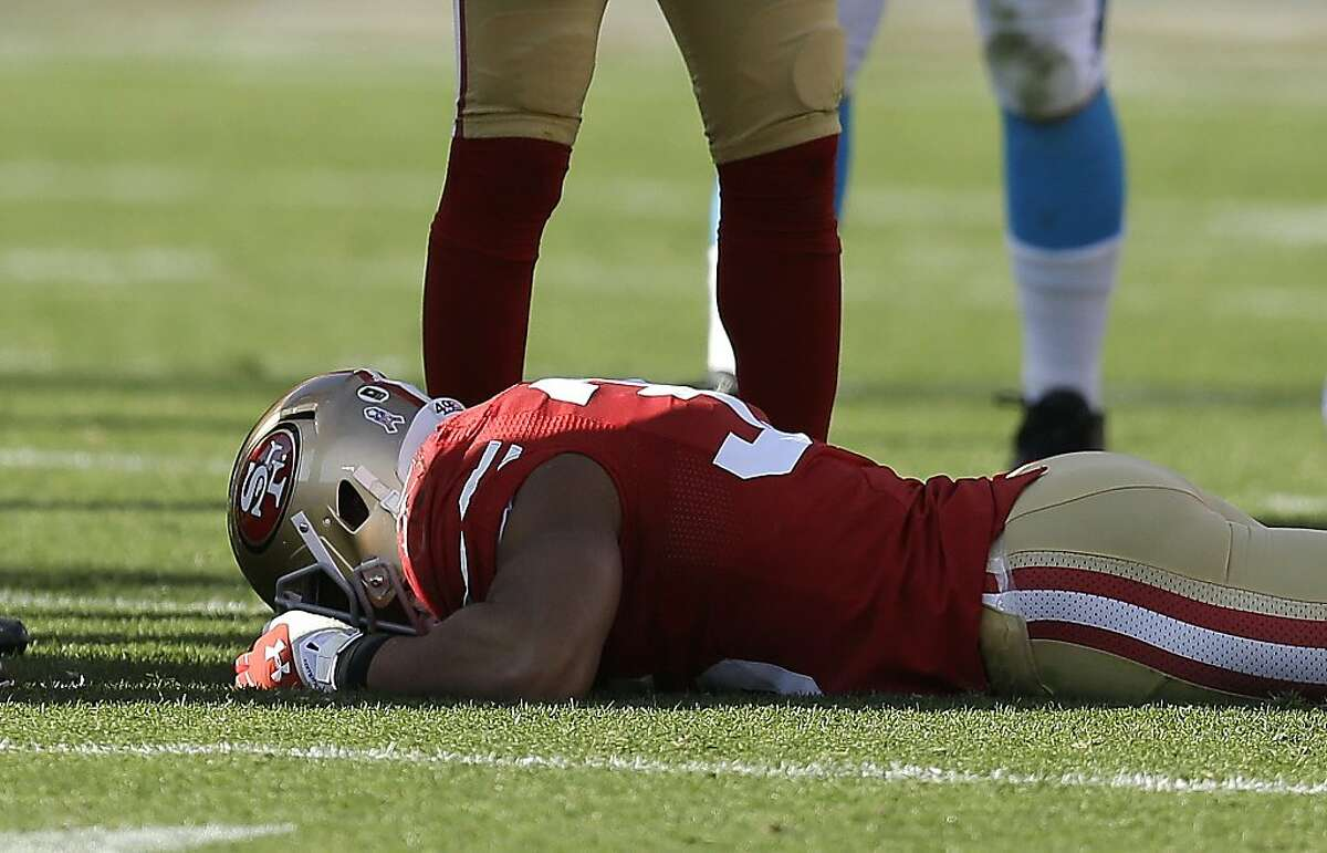San Francisco 49ers safety Eric Reid (35) lays on the ground after being injured during the second half of an NFL football game against the Carolina Panthers in San Francisco, Sunday, Nov. 10, 2013. (AP Photo/Ben Margot)
