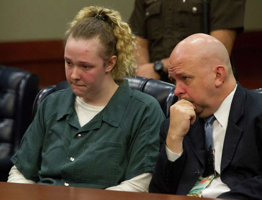 Abigail Catt, left, with attorney David Michael Ryan, right, has said she would testify against her dad. Photo: Bob Levey, Photographer / ©2013 Bob Levey