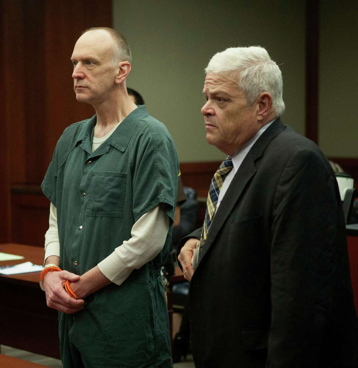 Ronald Scott Catt, left, and his attorney Sid Crowley stand before Judge Clifford Vacek in the 400th District Court, Thursday, Nov.14, 2013 in Richmond, Tx. Catt is accused of robbing several banks using his daughter and son in the Fort Bend County area. (Bob Levey/For The Chronicle)