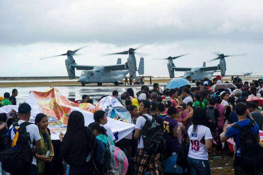 """The United States' Osprey aircraft is transporting disaster supply aid to the Philippines in the aftermath of Typhoon Haiyan. """"We are operating 24/7,"""" Marine Capt. Cassandra Gesecki says. Photo: Ricardo R. Guzman / Getty Images"""