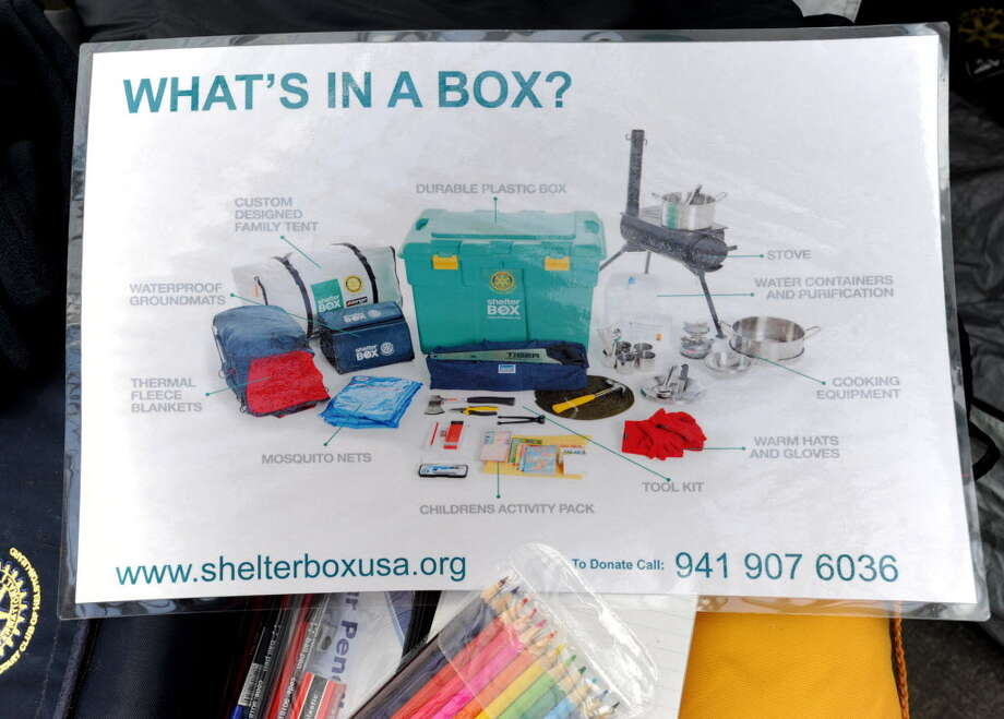A sign is displayed at a ShelterBox, to aid in the Japan earthquake relief efforts, at Faddegon's Nursery in Latham, NY on March 18, 2011. The contents of a ShelterBox, a self-contained humanitarian aid that can support up to 10 people for six months and it includes a tent, wood-burning stoves, pots and utensils. (Lori Van Buren / Times Union) Photo: Lori Van Buren / 00012453A