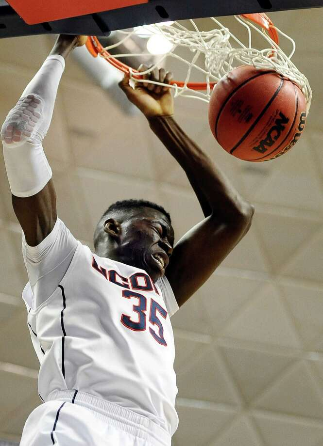 Connecticut's Amida Brimah dunks the ball during the second half of an NCAA college basketball game against Detroit, Thursday, Nov. 14, 2013, in Storrs, Conn. Connecticut won 101-55. Photo: Jessica Hill, AP / Associated Press