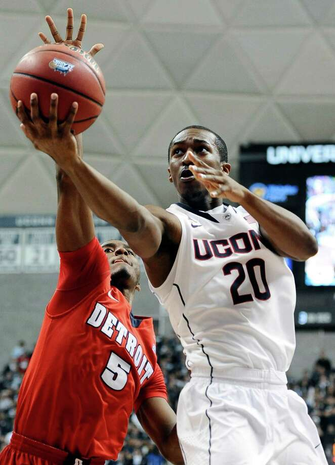 Connecticut's Lasan Kromah, right, drives to the basket as Detroit's Matthew Grant defends during the second half of an NCAA college basketball game Thursday, Nov. 14, 2013, in Storrs, Conn. Connecticut won 101-55. Photo: Jessica Hill, AP / Associated Press