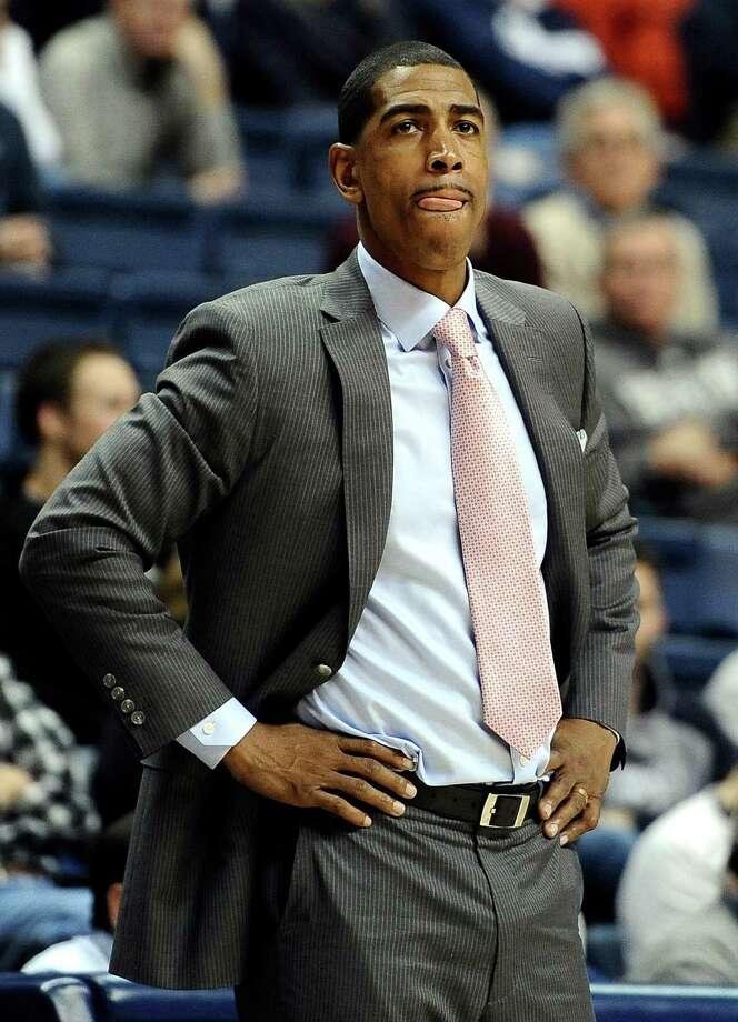 Connecticut head coach Kevin Ollie watches a play during the second half of an NCAA college basketball game against Detroit, Thursday, Nov. 14, 2013, in Storrs, Conn. Connecticut won 101-55. Photo: Jessica Hill, AP / Associated Press