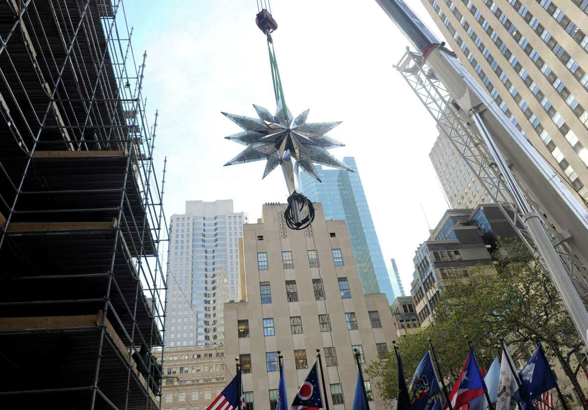 IMAGE DISTRIBUTED FOR SWAROVSKI -For the 10th year, the Swarovski Star is raised to the top of the 76-foot Rockefeller Center Christmas tree, Thursday, Nov. 14, 2013, in New York. The Star, features 25,000 crystals and weighs 550 pounds, will sit atop the Rockefeller Center Christmas tree which will be lit on Dec. 4th. (Diane Bondareff/Invision for Swarovski/AP Images) ORG XMIT: INVL