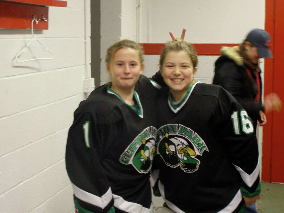 Longtime friends Nicole Beardsley, left, and Claire Virkler have been ice-hockey teammates since childhood. (Courtesy the Virkler family)