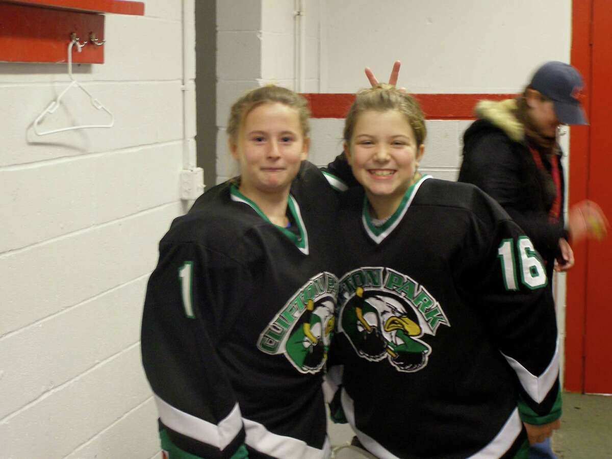 before game at Saranac Lake - Nichole on left, Claire #16