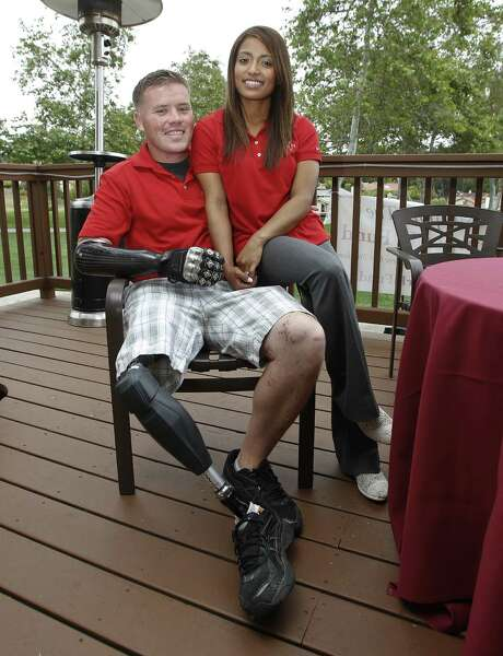 """Former U.S. Marine bomb technician Brian Meyer, shown sitting with his wife, Jessica, lost his right arm and leg and part of his left hand while defusing an IED in Afghanistan., """"Even when everything is done right, things can still go wrong,"""" he said in reference to the four Marines killed Wednesday at Camp Pendleton. Photo: Lenny Ignelzi / Associated Press"""