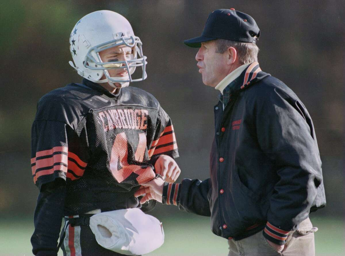 Times Union Staff Photo by LUANNE M. FERRIS. NOVEMBER 4, 1995. CAMBRIDGE FOOTBALL COACH KEN BAKER TALKS TO ONE OF HIS PLAYERS AT THE SECTION II CLASS C CHAMPIONSHIP. PLAYER IS THE QB, AND BILL A HAS HIS NAME.