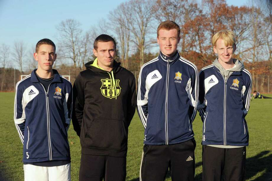 Averill Park High School boy's soccer players, left to right, Matt Ketzer, Wes Clayton, Myles Joyce and Evan Carrier during practice on Wednesday Nov. 13, 2013 in Albany, N.Y.  (Michael P. Farrell/Times Union) Photo: Michael P. Farrell / 00024608A