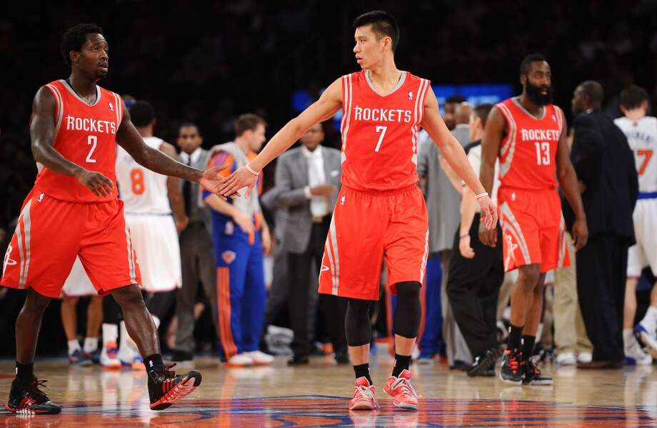 Patrick Beverley #2 and Jeremy Lin #7 of the Rockets high five before a time out. Photo: Maddie Meyer, Getty Images