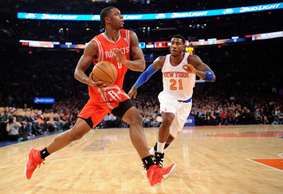 Terrence Jones #6 of the Rockets drives past Iman Shumpert #21 of the Knicks. Photo: Maddie Meyer, Getty Images