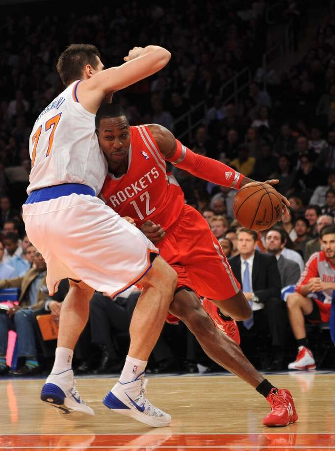 Dwight Howard #12 of the Rockets drives against Andrea Bargnani #77 of the Knicks. Photo: Maddie Meyer, Getty Images