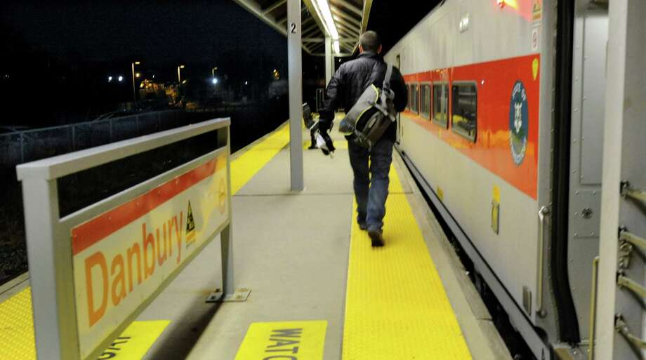 A man walks to get on the 5:15 p.m. train at the Danbury Train Station Thursday, Nov. 14, 2013. Photo: Carol Kaliff / The News-Times